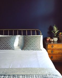 Dark walls and a copper bed