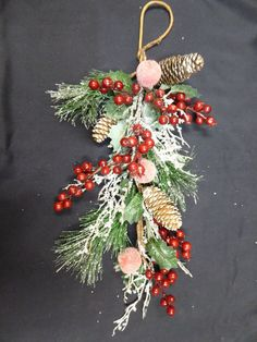 Stylish Christmas hanging swag decoration with an abundance of red berries, pine cones, silver twigs and frosted apples topped with snow on fir leaves and holly. The hoop at the top can be used to hang your swag. Red Berries, Pine Cones, Garden Furniture, Berry, Swag, Christmas Decorations, Wreaths, Accessories, Home Decor