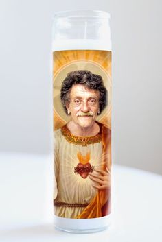 """Kurt Vonnegut  Saint Kurt Vonnegut featured on Illuminidol's Texas-made 8"""" prayer candle. The most divine way to bless any Vonnegut disciple!  Texas Made 8"""" in height Unscented Ships anywhere in the US via Priority Mail International Shipping? Please contact info@illuminidol.com Custom and Wholesale options available  #kurtvonnegut #writers #shortstory #novels #read #popular #famous #celebrities #pray #candles #art #beautiful #memes #blessed #lit #fire #funny #lol #austin #texas #local…"""