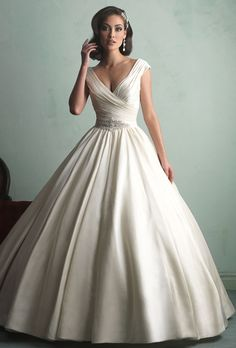 Brides: Allure Bridals  The cap sleeves are perfect and so is the fullness of the skirt! Not sure if I could do the satin instead of the lace but maybe with a dropped waist and beading :)