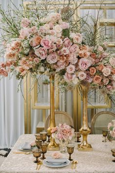 Tall, Blush Floral Arrangement in Gold Vases | Photography: Krista Mason Photography. Read More:  http://www.insideweddings.com/weddings/romantic-victorian-inspired-tablescape-featuring-classic-colors/810/