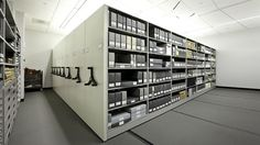 Archival collection storage with mobile & 4-post shelving system