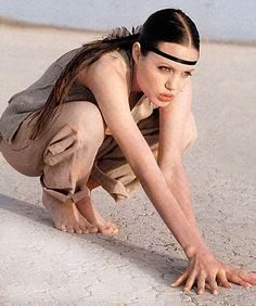 The long lost pictures, taken when Jolie was just 18, were published under the headline 'Honeychild' in Look in 1993 and included shots of hersquatting on the floor of a desert wearing a headband