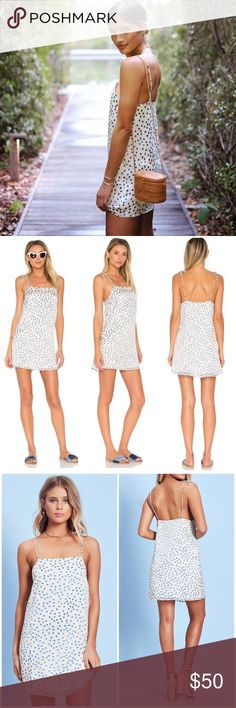 LOVERS + FRIENDS ROCKY BARNES BLOGGER REFORMATION Effortless double layered slip dress from Lovers + Friends, seen on Rocky Barnes in Turks & Caicos (and a few other bloggers as well). This baby has super Reformation vibes and fits easy and floaty, true to size. Lined inner with floaty outer and soft, shimmery, velvety dots. Spaghetti straps tie at top for adjustable fit. Super light and packs amazingly! New without tags from our showroom ✨ Lovers + Friends Dresses Mini