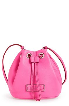 Definitely crushing on this fuchsia pink Marc Jacobs drawstring bag.