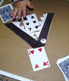 Split a deck of cards. Children flip up a card. The crock eats the lesser one and the greater one goes in your winnings pile.