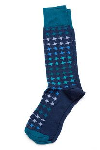 Our houndstooth dress socks for men offer a classic look with a touch of color. Shop mens dress socks and more at www.HookAndAlbert.com.