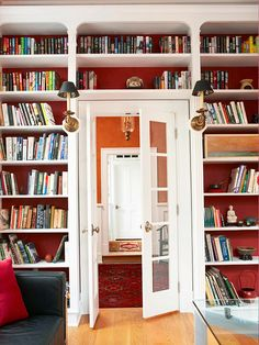 We love these doorway savvy bookshelves! More tips for arranging bookshelves: http://www.bhg.com/decorating/storage/shelves/get-picture-perfect-bookshelves/?socsrc=bhgpin082613doorway=2