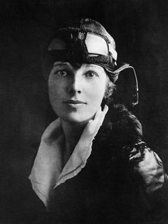 Amelia Earhart - first female pilot to fly solo across the Atlantic Ocean, earning her the Distinguished Flying Cross.
