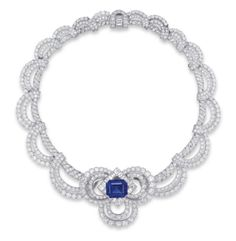 DESIGNED AS A SCROLLING NECKCHAIN OF BRILLIANT AND SINGLE-CUT DIAMONDS ALTERNATING WITH SQUARE AND BAGUETTE-CUT DIAMONDS, SUSPENDING A SCALLOPED FRINGE OF BRILLIANT-CUT DIAMONDS, THE FRONT SET WITH A DETACHABLE BROOCH, CENTERING UPON AN OCTAGONAL-SHAPED SAPPHIRE WEIGHING APPROXIMATELY 17.95 CARATS, WITHIN A SQUARE AND BAGUETTE-CUT DIAMOND LOZENGE SHAPE BORDER AND TWO-TIERED BRILLIANT-CUT DIAMOND TREFOIL SURROUND (WITH ADDITIONAL NECKLACE FITTING), MOUNTED IN PLATINUM, 36.5 CM LONG