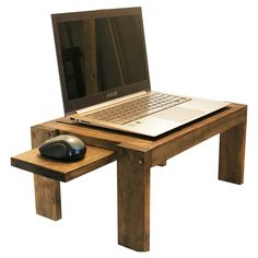 Crafted from Australian Poplar with your choice of stain (Dark Walnut, Early American, English Chestnut or Ebony), this stand is compatible with any laptop and...