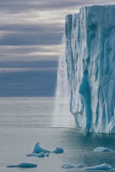Glacial Waterfall by Mike Reyfman  ♥ ♥   www.paintingyouwithwords.com