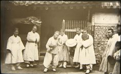 """""""Clowns with drum outside of entryway."""" Percival Lowell photo ca. 1882."""