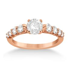 Allurez. See more details from Allurez.com��Graduated diamond accented engagement ring in 14K rose gold. Eight round cut diamonds lining the band in a magnificent contemporary style. Diamonds appear as though they are floating away from the band. The prong set diamonds are of G-H color and VS2-SI1 clarity, approximately 0.50ctw. Build your own engagement ring by choosing a round cut diamond from our selection of conflict-free diamonds.
