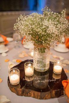 tea lights surrounding the ball jar wedding centerpiece / http://www.deerpearlflowers.com/unique-wedding-centerpiece-ideas/3/