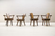 four-mid-century-wooden-chairs