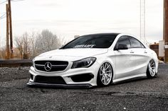 Take a look at the White Lowered Mercedes CLA Class Customized with Exotic in Mind photos and go back to customizing your vehicle with renewed passion. Mercedes Benz Cla 250, Custom Mercedes, Mercedes C300, Mercedes Benz Models, Fuel Cell Cars, Cadillac, Luxury Cars, Dream Cars, Cars