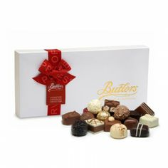 Butlers Embossed Signature Christmas Assortment Butlers signature chocolate assortment features a premium collection of luxury chocolate truffles and pralines in milk, dark and white chocolate. The assortment includes; milk chocolate Irish cream truffle, dark chocolate 70% truffle and white chocolate flake. This selection contains 18 assorted chocolates in a single layer and some chocolates contain alcohol.