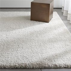 Shop Memphis White Shag Rug.  The shag never skips a beat when re-choreographed in stain-resistant, colorfast polypropylene.  It has the same sink-in softness as wool, without the shedding.