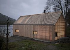 Norwegian boathouse appears to be entirely made of wood, whilst at night sections of the roof and walls glow