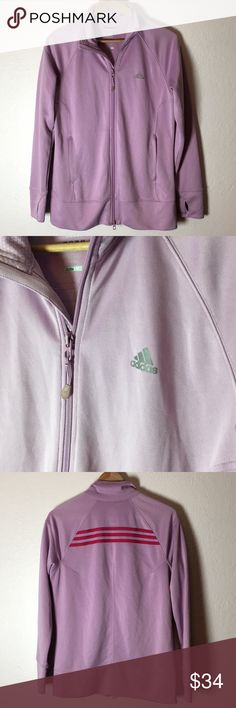 Adidas Lavender Track Jacket This track jacket is a lavender color with pink stripes on the back. Has thumb holes and two zippered pockets. Hanging loop has a small hole on it, not noticeable but worth mentioning. Very gently used condition. Size L. adidas Jackets & Coats