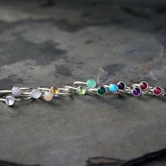 Create your own unique set of stacking rings. Select a stacking ring to represent your birthday or the birthdays of the ones you love. Or, create your own colorful set by mixing and matching your favorite colors and gemstones. The gems are 5mm. Set in solid sterling silver. January - Garnet February - Amethyst March - Aquamarine April - Clear Topaz May - Green Onyx June - Pearl July - Lab Ruby August - Peridot September - Lab Sapphire October - Lab Opal November - Citrine December…