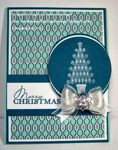 "Stamps: Contempo Christmas (retired) Paper: Whisper White, Island Indigo, Winter Frost DSP Paper Size: A2 Card Ink: Island Indigo, Silver Encore!™ Metallic Accessories: 5/8"" Whisper White Organza Ribbon, Frosted Finishes Embellishments   Read more: http://www.splitcoaststampers.com/gallery/photo/2452118#ixzz2nSgNrjoz"