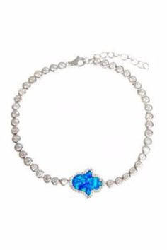 """Be protected with this gold-plated turquoise Hamsa hand bracelet. Cz's surround both hamsa and bracelet. -bracelet is 6"""" with 1"""" extender -sterling silver -lobster clasp -cz's   Gold-Plated Hand Bracelet by Lets Accessorize. Accessories - Jewelry - Bracelets New York"""