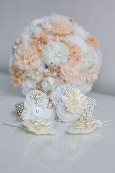 Fabric brides bouquet, wristlets and buttonholes, all rights reserved 2015 Panache photography. Bride Bouquets, Alternative Wedding, Buttonholes, Wedding Designs, Wristlets, Brides, Floral Design, Pearl Earrings, Brooch