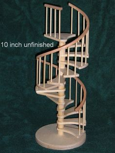 1/12 scale wooden (unfinished) spiral staircase KIT. Handmade one at a time. This kit has a CURVED landing tread to fit a round or curved landing area. Finished height without round base is 10 to TOP of landing tread (top step). Assembly instructions included. Finished stairs can be removed from base to be used in a dollhouse or left on base as an architectural display.    Staircase diameter is 5-1/4, total height is approx. 13.    Ships 2-3 days after order is placed, shipped prior...