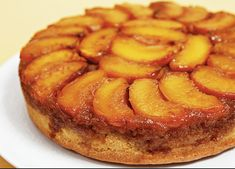 Fresh peach halves in a nutmeg-spiced sauce top this buttery upside down cake. Ingredients: cup butter cup packed brown sugar 1 cups sliced, pitted and peeled peaches or frozen unsweetened peach slices, Cranberry Upside Down Cake, Peach Upside Down Cake, Pineapple Upside Down Cake, Homemade Caramel Sauce, Caramel Recipes, Dessert Cake Recipes, Just Desserts, Lemon Ricotta Cheesecake, Peach Cake