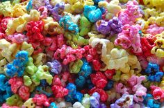 rainbow snack - 3 to 4 qt. unsalted popped corn  3 c. sugar  1 c. water  Food coloring    Cook sugar and water to the hard crack stage. Add your food coloring and pour over popped corn and stir immediately and fast until it turns sugary. I use red at Christmas time. Make a batch of red and green and mix them together.