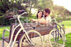 Couple in love sitted togheter on a bench with bikes royalty-free stock photo