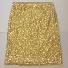 Gold Skirt Gold sequence skirt. Can be worn high waisted or regular. Elastic waist. Slip attached. Worn once Forever 21 Skirts