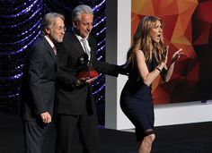 Chileanborn American record producer Humberto Gatica poses with President and CEO of The Recording Academy Neil Portnow and singer Celine Dion as he...