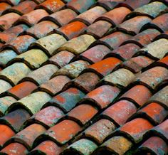 Roman clay roof tiles in an aged colorful range of glazes.