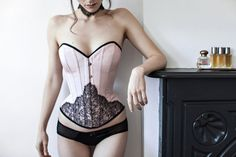 Evelyn is a sophisticated and chic overbust corset in pink bengaline with black French lace overlay and black edging. This corset will be the star