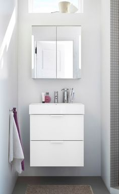 Small bathroom organization can be easy when you combine the GODMORGON sink and mirror cabinets.