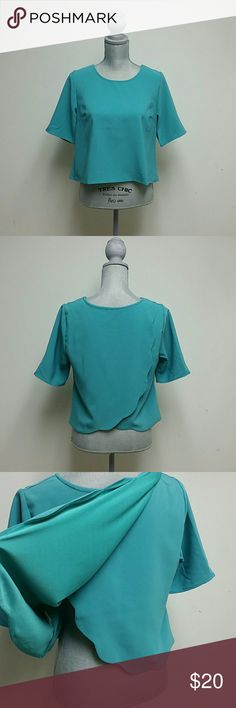 Teal Crop Top Never been work. Teal short sleeve crop tip with crew neckline and scalloped layered open back. 95% polyester 5% spandex lining is 100% polyester   Brand is Harper by Francescas Francesca's Collections Tops Crop Tops