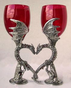 For our romantic wine lovers, at last! These dragons nuzzle and curl their tails together, forming a heart between them. Crystals sparkle down their sides, and crystal balls are caught among the rocks below. Each glass easily holds 10 ounces of your favorite libation.