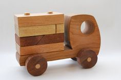 ИЗГИБЫ I love all the curves in Israeli designer Gad Agmon's wooden toys . Handmade from oak and mahogany, they are simple, . Wooden Toy Trucks, Wooden Car, Woodworking Toys, Diy Holz, Designer Toys, Learning Toys, Wooden Crafts, Wood Toys, Classic Toys