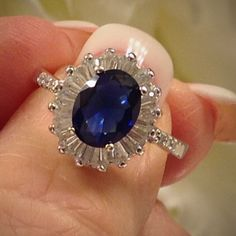 Blue Sapphire 3ct 3 carat Oval Blue Sapphire surrounded by White Sapphires Baguette cut. There are 6 round White Sapphires set into the shoulders of this sparkler! This is a gorgeous 925 Sterling silver and gemstone ring! It will be shipped immediately and delivered in a gift presentation box!❤️ Jewelry
