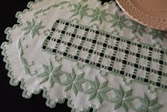 This gorgeous and extremely detailed light mint green on cream hardanger embroidery doily was stitched on cotton hardanger cloth with