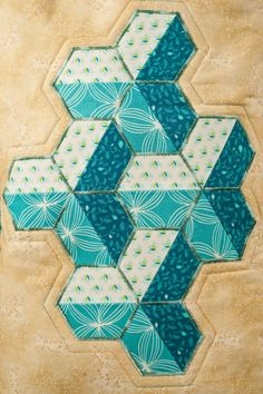 Inner City - A different use of hexagons to create this 3D effect. Hexagons are a traditional favourite and are enjoying a revival; in this workshop Valerie shows you how to rotary cut this shape (with the help of a special template to keep you safe !) plus how to applique the shapes onto the cushion.