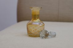 perfume bottle. amber in color. order online. great gift idea. vintage. classic.