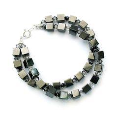 Hematite and grey Swarovski crystals.  Heavy, industrial, metallic.