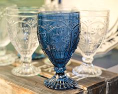 Adorn your tabletop with the Fitz and Floyd Trestle Set of 4 Indigo Goblets or 4 Clear Goblets. These glasses are decorated with a gorgeous, intricate pattern reminiscent of classic bridge architecture. They're a charming, upscale way to serve wine, juice or anything in between.
