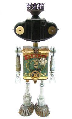 """Bazoo"" Height: 14"" Principal Components: Tea tin, Brownie 127 camera, gas lamp burner, toggle bolts, hose fittings, tartlet tins, c..."