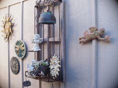 Garden/Wall art, a nice happy mix, with a single demure succulent. Great ideas here; filling up the side walls with cheer. Garden Wall Art, Side Wall, My Secret Garden, Wind Chimes, Cheer, Succulents, Walls, Nice, Happy