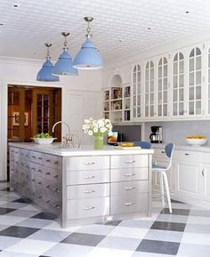 marmoleum.  Another plaid effect kitchen floor.  Looks modern and fresh!